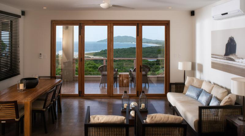 Living area opens with open bi-folding doors - Stunning 3-Bed Villa w/ Ocean Views in Tamarindo - Tamarindo - rentals