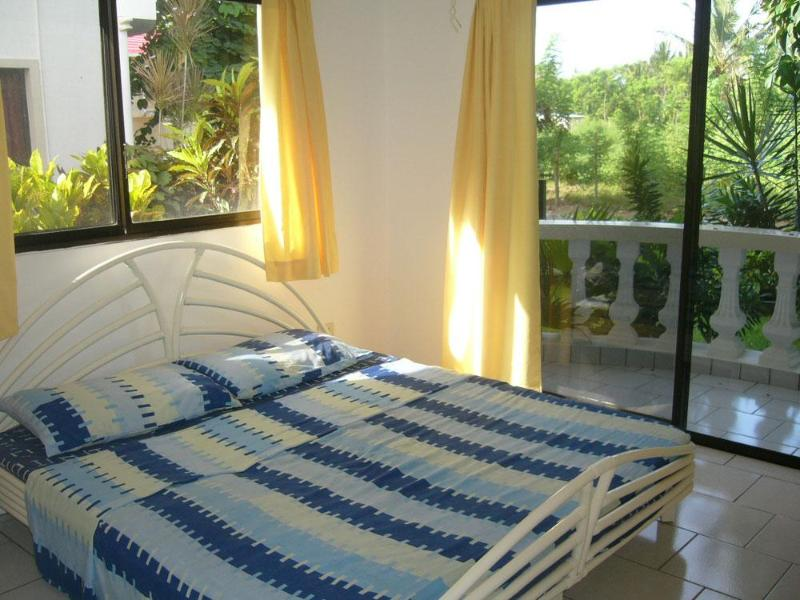 Bedroom with balcony - Charming one bedroom apartment near the ocean - Cabarete - rentals