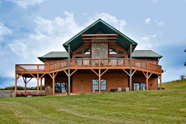 Back view from the yard showing expansive decks and A frame design - SPECIAL OFFER-Pet-Friendly 4BR Waynesville Family Cabin w/Hot Tub & Great Views - Waynesville - rentals