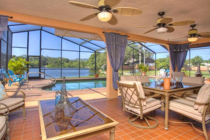 Outside lanai overloooking lake - 3000sq ft private gated Estate 5 miles to beach! - Bradenton - rentals