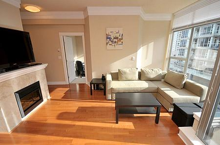 Living room with fireplace and wide screen TV - Downtown 1 Bedroom Victoria Condo Walk to All Amenities and Attractions - Victoria - rentals