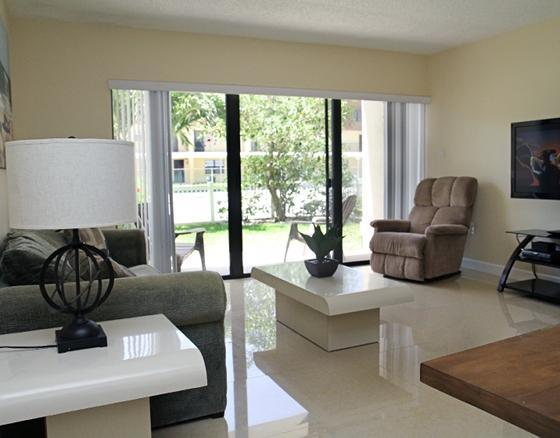 "Bright and Open Living Room (Pullout Couch, Walk out to Patio, 52"" LCD TV, BluRay) - Bright Ground Floor Corner Unit - Next to Pier! - Cocoa Beach - rentals"