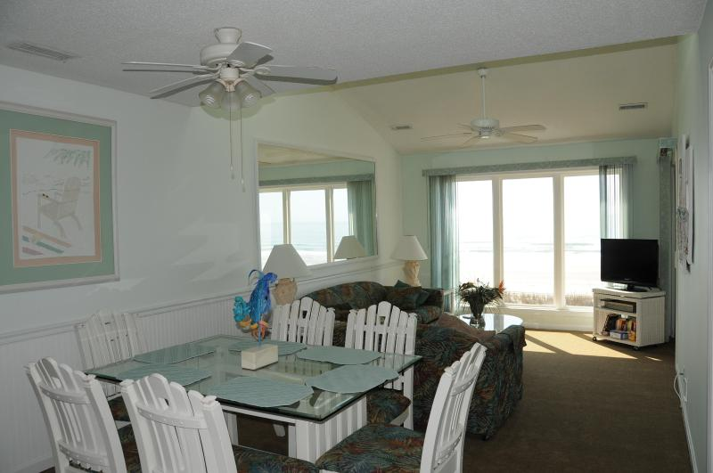 Dining area looking toward living room. Check the large window which is direct view of ocean.  - EVERYONE SAYS BEST VIEW OF OCEAN FROM OUR CONDO - North Myrtle Beach - rentals