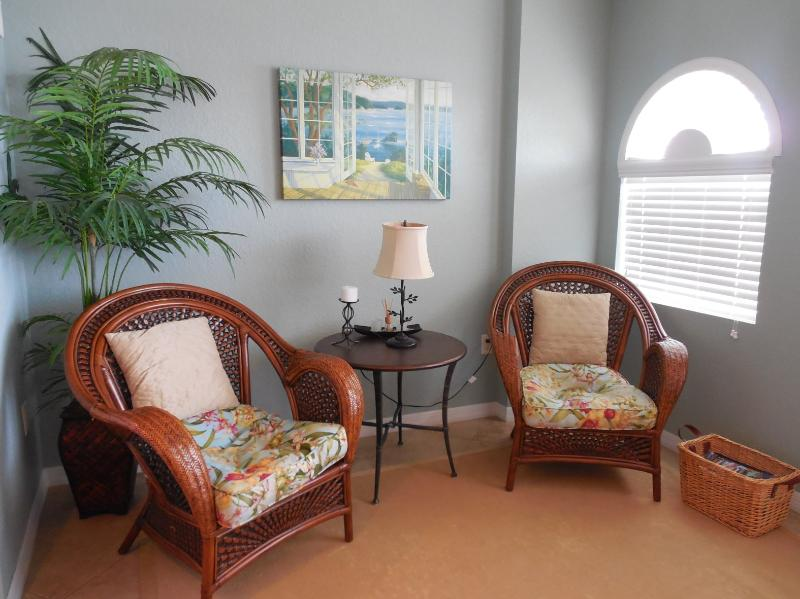 Comfortable seating area. Open the window, feel the breeze and watch the dolphins! - Dockside Condo 405 | Book LOW May prices!! - Clearwater - rentals