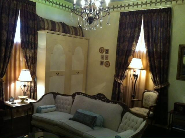 The living room has a custom queen wall bed. - Isabella House: Vintage 1885 Cottage  601-660-4345 - Natchez - rentals