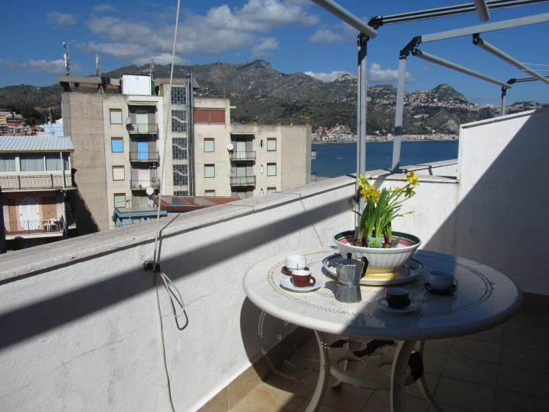 Terrace with the view over the sea and Taormina - Beachfront 1-bedroom apartment with perfect view! - Giardini Naxos - rentals