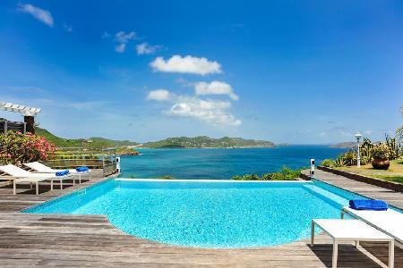 Sunny L'Abri Cotier boasts stunning ocean views & cliff-top infinity pool - Image 1 - Pointe Milou - rentals