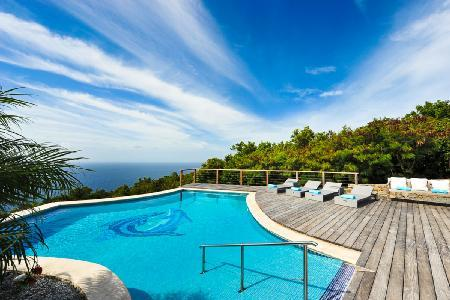Modern oasis Grand Large offers superb ocean views & hillside terrace with pool - Image 1 - Gouverneur - rentals
