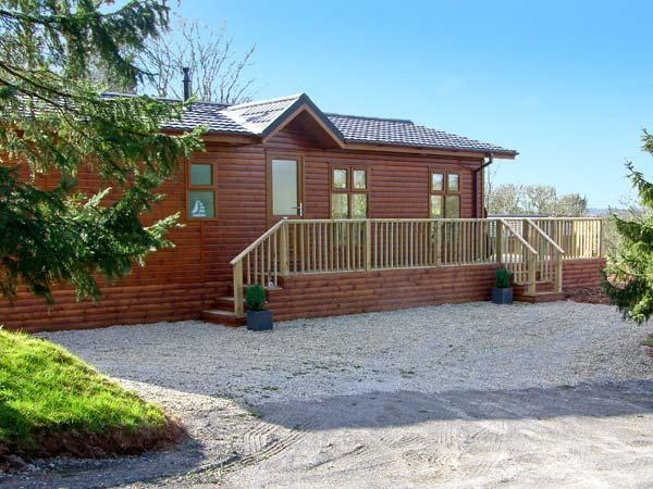 FIRS LODGE, romantic, luxury holiday lodge, with hot tub, golf and fishing in - Image 1 - Narberth - rentals