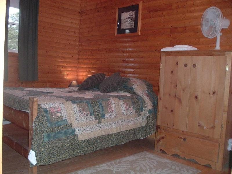 master bedroom, handcrafted furniture - Grand Fairways Log Chalet - Frenchman's Cove - rentals