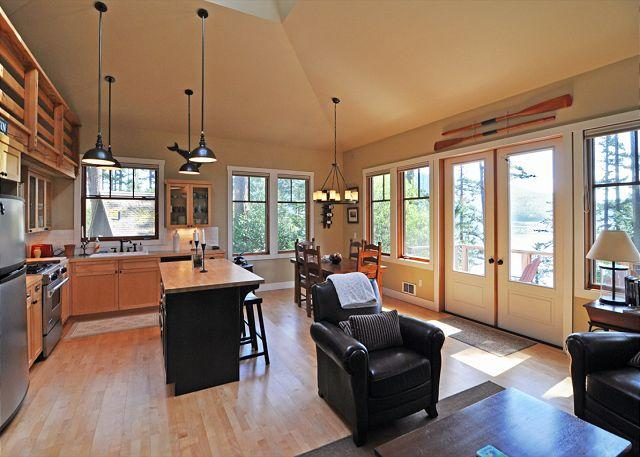Open floor plan features vaulted ceiling and view of the water. - Wild Currant Bungalow on Orcas Island - Eastsound - rentals