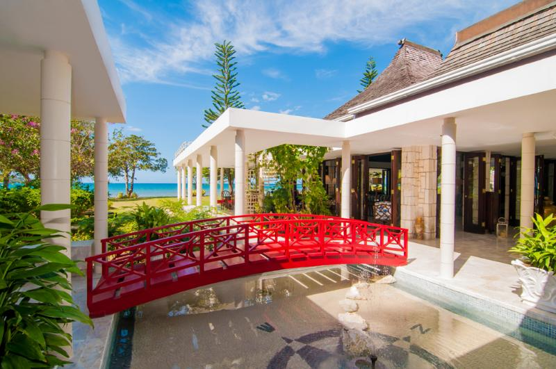 A signature red bridge leads from the main pavilion ... - 5 Bedroom Villa with Private Veranda in Montego Bay - Montego Bay - rentals