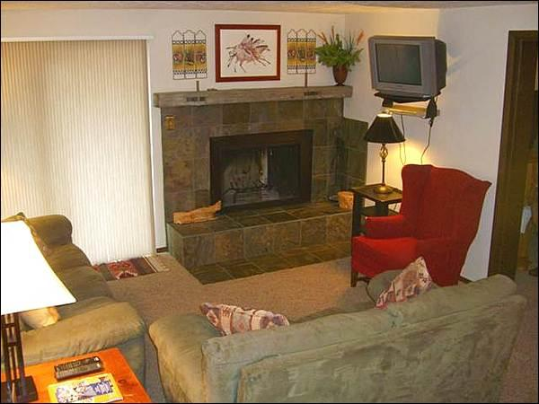 Living Room Includes a Wood-Burning Fireplace and TV - Great Condo for Groups or Families - Beautifully Furnished & Decorated (1253) - Crested Butte - rentals