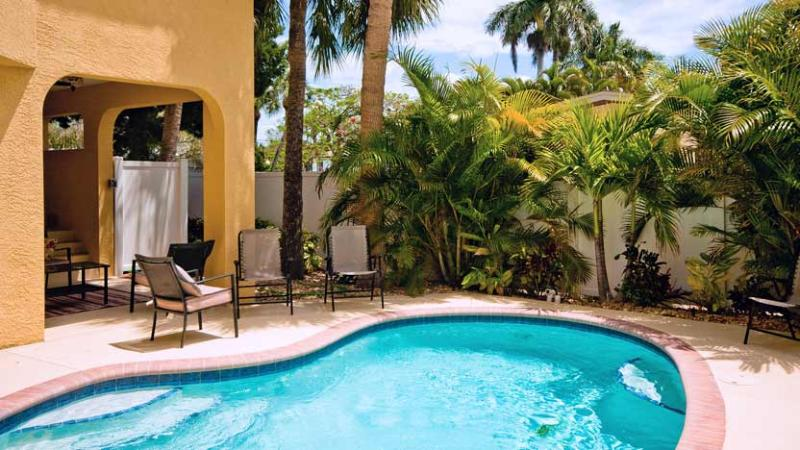 Tropical Landscape - Carissa Villa 201: 3BR Family-Friendly Pool Home - Holmes Beach - rentals