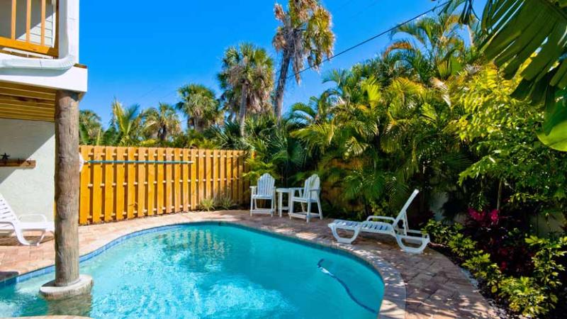 Relaxing Backyard with Heated Pool - Southern Comfort: 2BR Pool Home, Block from Beach - Holmes Beach - rentals