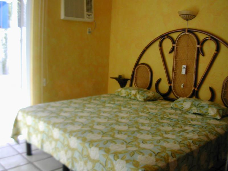 Bedroom that opens out to back patio - Property Has Sold - No Rentals - Puerto Morelos - rentals