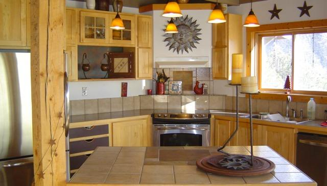 The gourmet kitchen has stainless appliances, an island, a walk-in pantry & a window over the sink. - HIGH COUNTRY HEAVEN - a billion stars all around!! - Salida - rentals