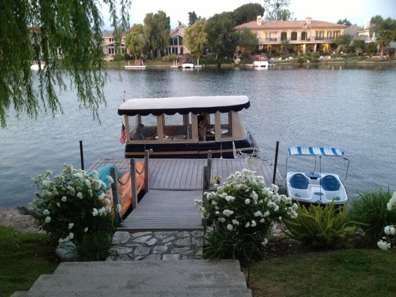 View of boat and peddle boat, from house - Lake House - Westlake Village - rentals