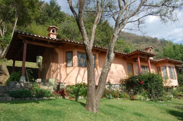 The house perched on the hilltop, provides stunning views of the lake and town below. - Casa Juana - Spectacular views, magical & secluded - Panajachel - rentals