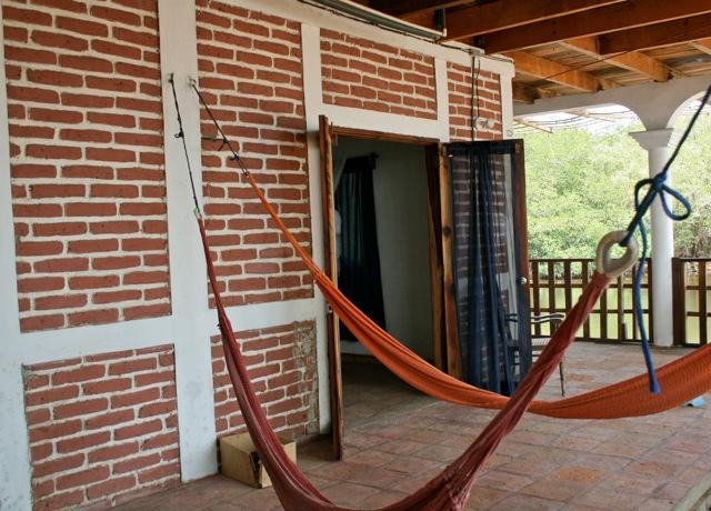 Outdoor patio with views of the ocean and estuary. Double doors lead into the room. - Beachfront Mini Apartment - Playa Gigante - rentals