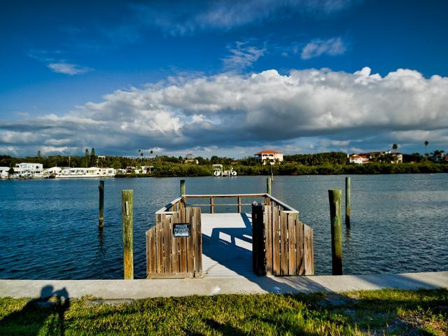 Fishing pier across road from unit - West Coast Vista 3E Bay View Condo | Sunrise  and  Sunsets! | Recently Remodeled! - Indian Rocks Beach - rentals