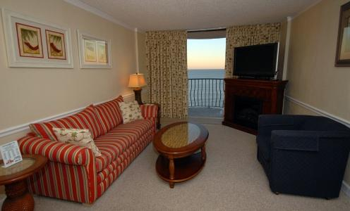 Living room opening to oceanfront balcony. - Palms PH5 Soar with the birds - Oceanfront Penthouse - Myrtle Beach - rentals