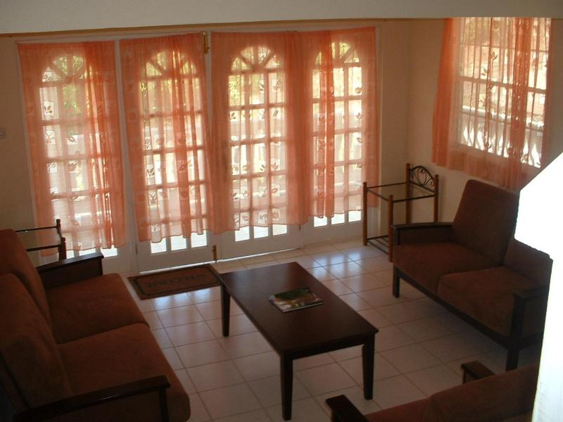 Living room locates on the 1st level of the house - Rental for a group or a large family - Gros Islet - rentals