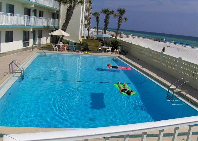 Slip on the shades and stroll to the beach from this ground floor unit. - Image 1 - Fort Walton Beach - rentals