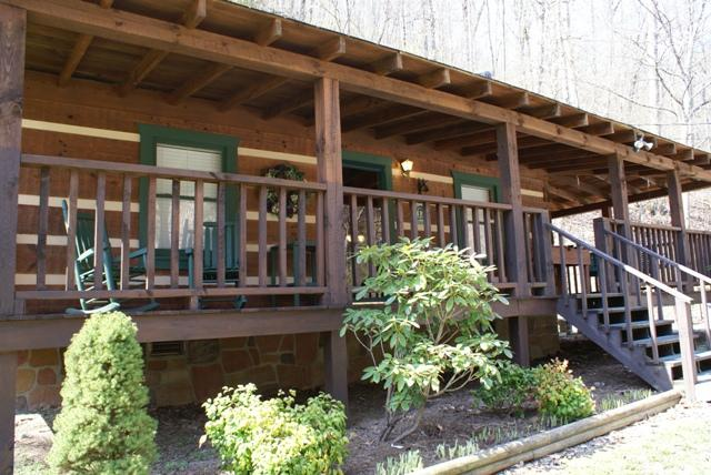 The porch features  rockingchairs and swing - Honeymoon Hideaway - Smoky Mountain Cabin - Sevierville - rentals
