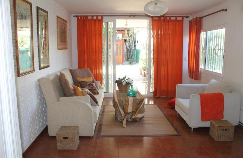 This living room faces the rear garden, and it becomes the 4th bedroom if you use the sofabed. - Beautiful House in the Beach at COSTA BLANCA - Alicante - rentals