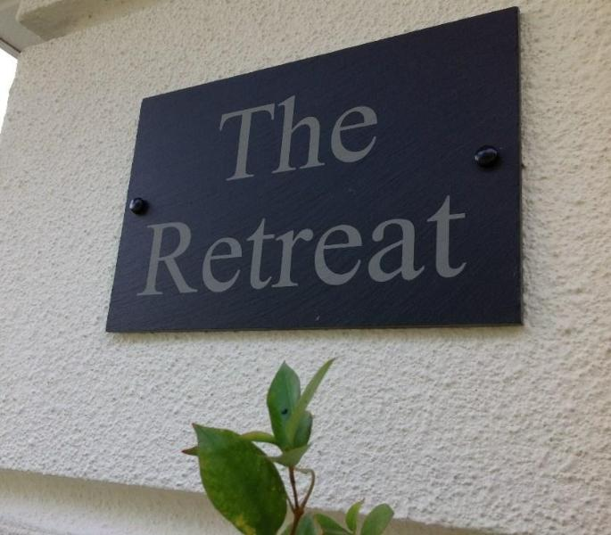A sign of luxury, 'The Retreat' sign - 'The Retreat' - Explore Disney & Florida in style - Kissimmee - rentals