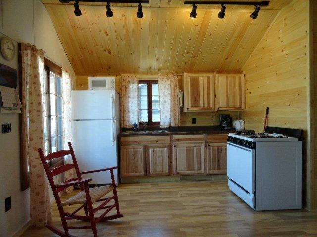 Full kitchen with high, open ceilings.   - 2BR Moosehead Cabin with Screen Porch & Woodstove - Rockwood - rentals