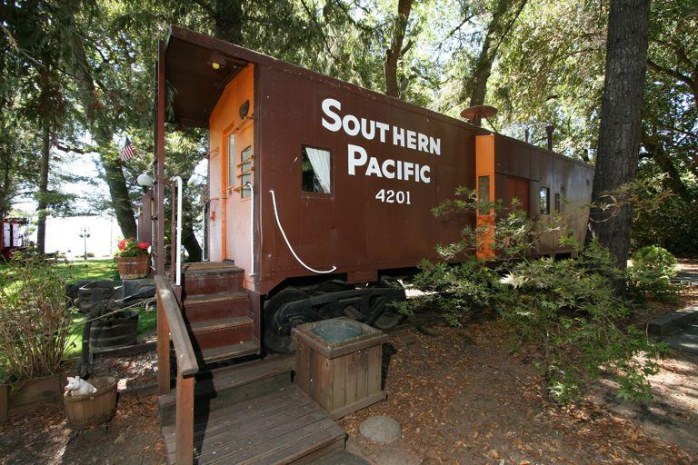 Lovers Caboose - nestled among the trees - Sleep in a caboose on Clear Lake - Nice - rentals