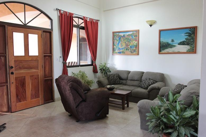 Condo #3 living/entryway - New 1BR Playa Junquillal Condo at Tierra Pacifica - Playa Junquillal - rentals