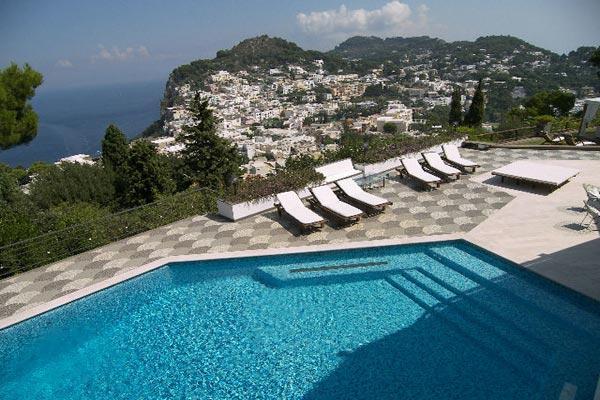High on Castiglione hill, this villa offers breathtaking views of the Mediterranean, Mount Vesuvius and Capri. LDG GUI - Image 1 - Capri - rentals