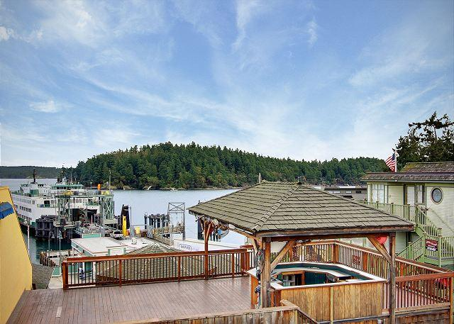 Watch the comings and goings of the ferry and other boat traffic from the High Seas. NOTE: Deck in picture is a restaurant on top of another building. - San Juan Suites - High Seas! - San Juan Island - rentals