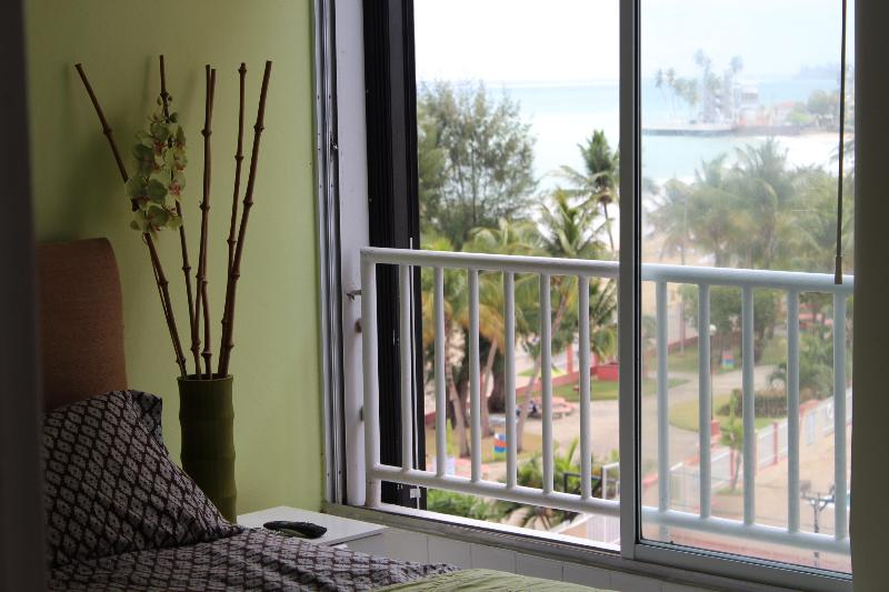 Beach view from the bedroom - Beautiful Beach Front Location  5 minutes from the airport - San Juan - rentals
