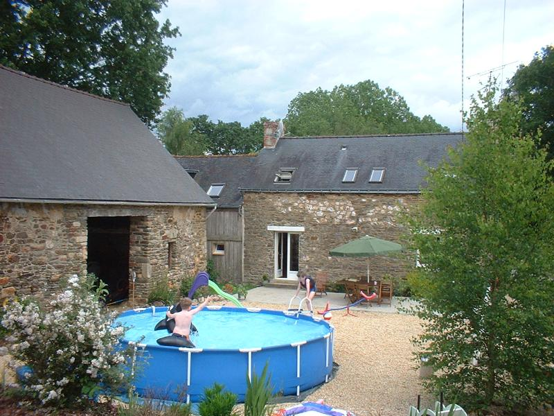 Relax on the spacious patio with BBQ and pool - Comfortable family farmhouse Gite rental - Josselin - rentals