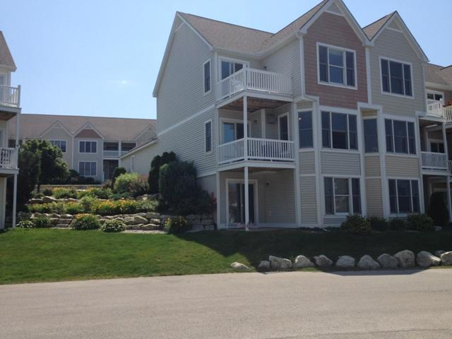 Spectacular Three Story Condo with Beach-Like Feel - Image 1 - Manistee - rentals