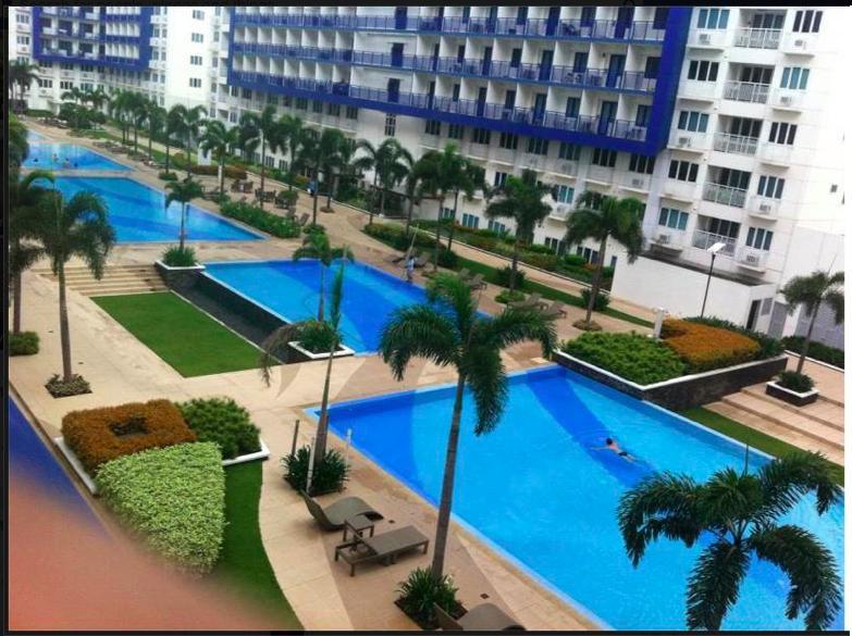 6 swimming pools/View from our balcony - Hotel-Condo Near Mall of Asia, Pasay City, Manila - Manila - rentals