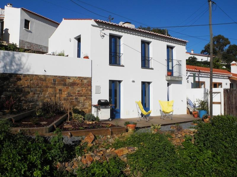 The house! The wooden deck is on the bottom level and the patio area on the top level or the house. - Romantic retreat in Aljezur old town - Aljezur - rentals