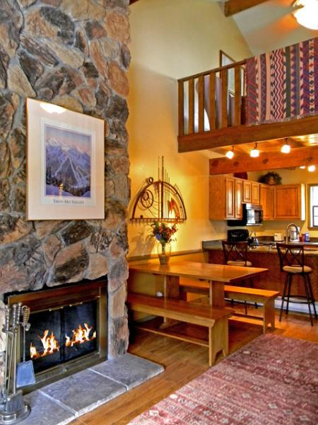 2nd floor living room, dining, kitchen with 2 story granite boulder wood burning fireplace, 3rd story loft - Twining 9 - Taos Ski Valley - rentals
