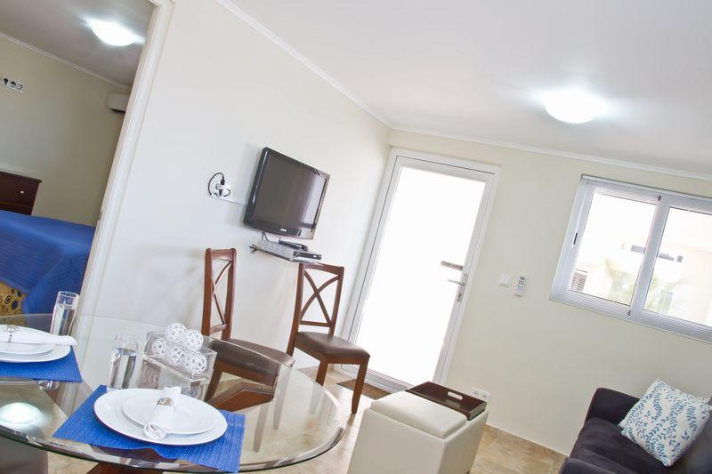 LCD TV in the living room. - Royal Palm Resort. Moderm one bedroom apartment. In upscale Piscadera Bay. - Willemstad - rentals