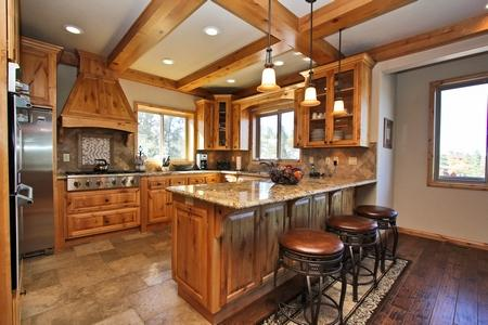 The kitchen features granite counter tops, stainless steal appliances and a 6 burner gas stove. - Whispering Springs- High End! Beautiful! Gameroom! - City of Big Bear Lake - rentals