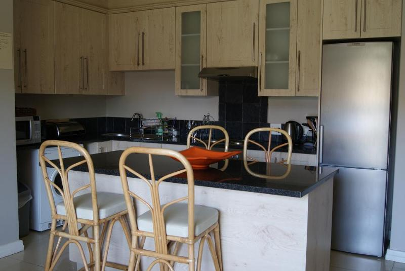 Fully equipped kitchen with eating counter - Madison on First Two Bedroom Unit - Port Elizabeth - rentals