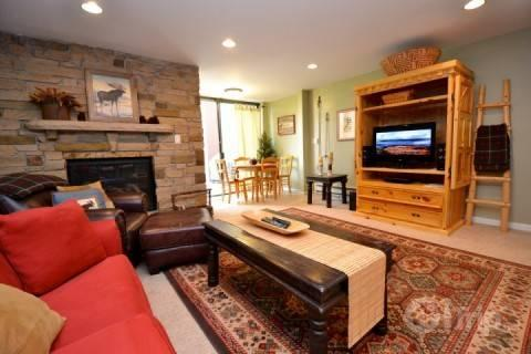 Living area with natural stone fireplace, HDTV, dining for four (4) and access to the backyard deck / patio. - Three Kings Eagle - Park City - rentals