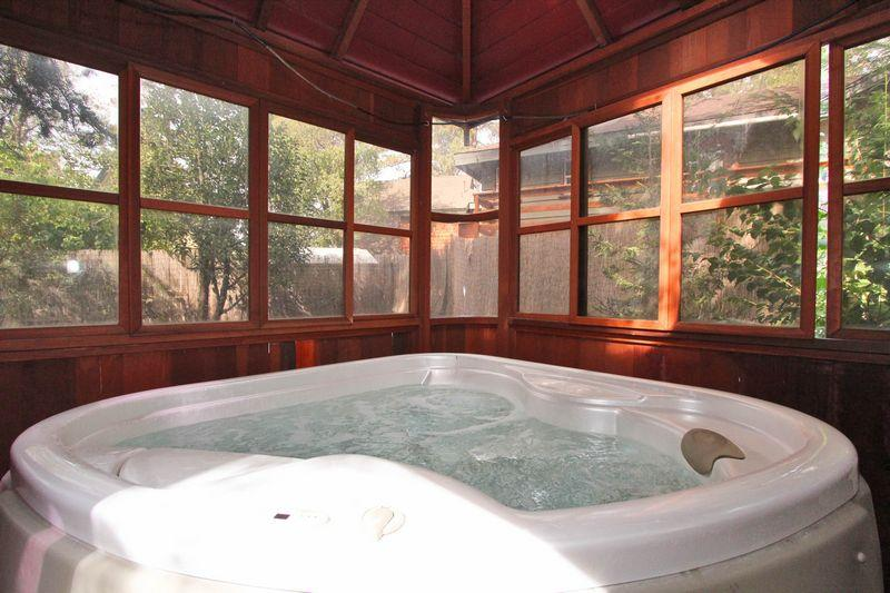 Sit back and relax in the covered hot tub! - Bear Necessities - Hot Tub! Budget! Affordable! - Moonridge - rentals