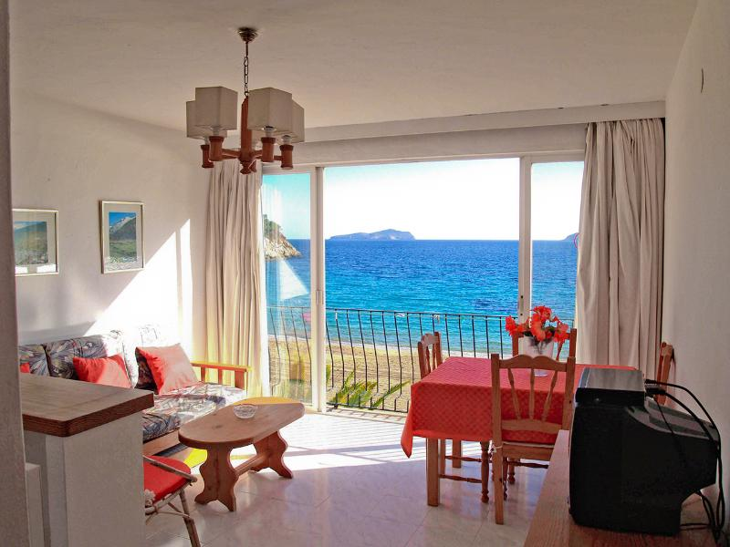 Livingroom with 180° first line beach views - Ibiza apartment AT the beach what more do you need - Ibiza - rentals