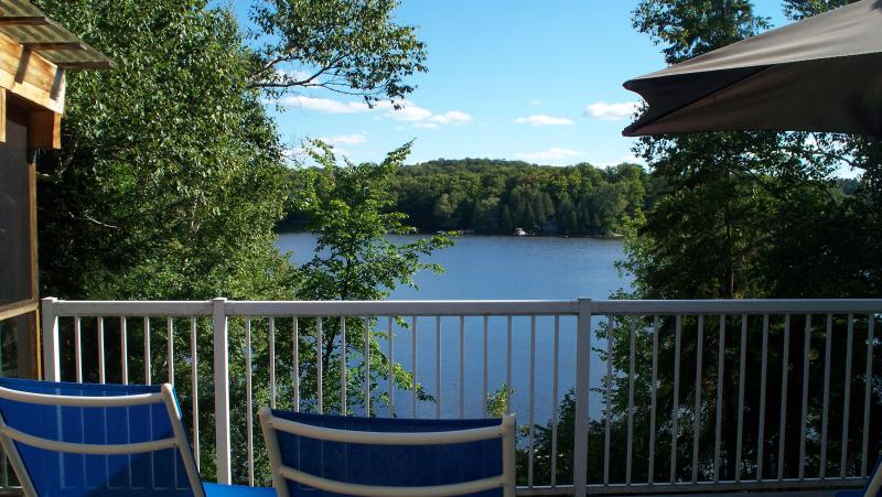 View from the large deck, partly screened-in with Dining Table - Beautiful Modern LAKESIDE Cottage in Haliburton - Haliburton - rentals