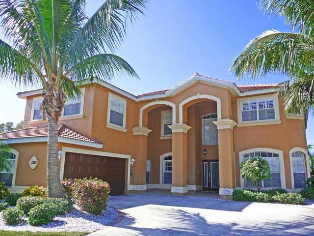 Front of home with huge driveway - Luxury Direct Access Pool/Spa Estate Size Home - Cape Coral - rentals